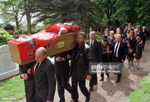 Draped in a Manchester United banner signed by the club and with a Cantona shirt made from flowers the coffin of Christopher Scott arrives at St...