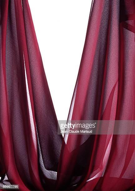 Draped sheer red fabric