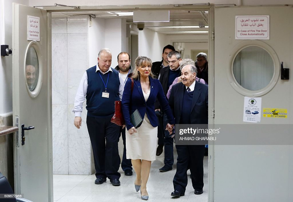 Dr.Arafat Hidmi(R), Chairman of the administrative board, Dr.Rafiq Husseini (L), manager of the Makassed hospital, and Martina Anderson (C) member of the European Parliament and chair of the European Parliament delegation for relations with Palestine, arrive at the Makassed hospital ahead of a press conference in East Jerusalem, on February 11, 2016. / AFP / AHMAD GHARABLI