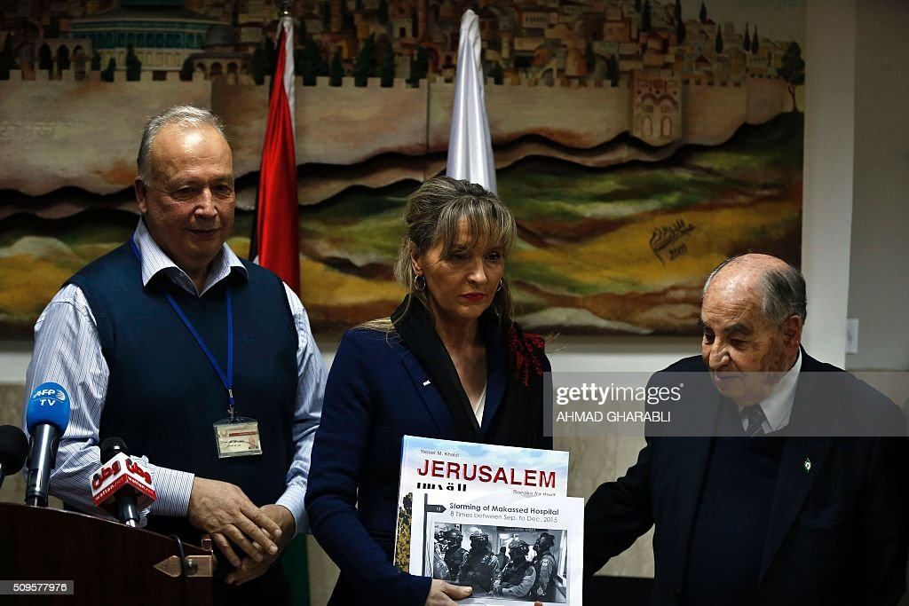 Dr.Arafat Hidmi(R), Chairman of the administrative board, Dr.Rafiq Husseini (L), manager of the Makassed hospital, and Martina Anderson (C) member of the European Parliament and chair of the European Parliament delegation for relations with Palestine, gather for a press conference at the Makassed hospital in East Jerusalem, on February 11, 2016. / AFP / AHMAD GHARABLI