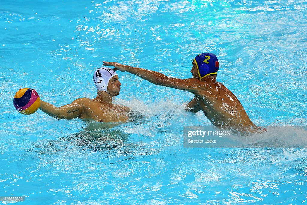 Drasko Brguljan (R) #2 of Montenegro challenges Denes Varga #4 of Hungary during their Men's Water Polo preliminary round Group B match on Day 4 of the London 2012 Olympic Games at Water Polo Arena on July 31, 2012 in London, England.