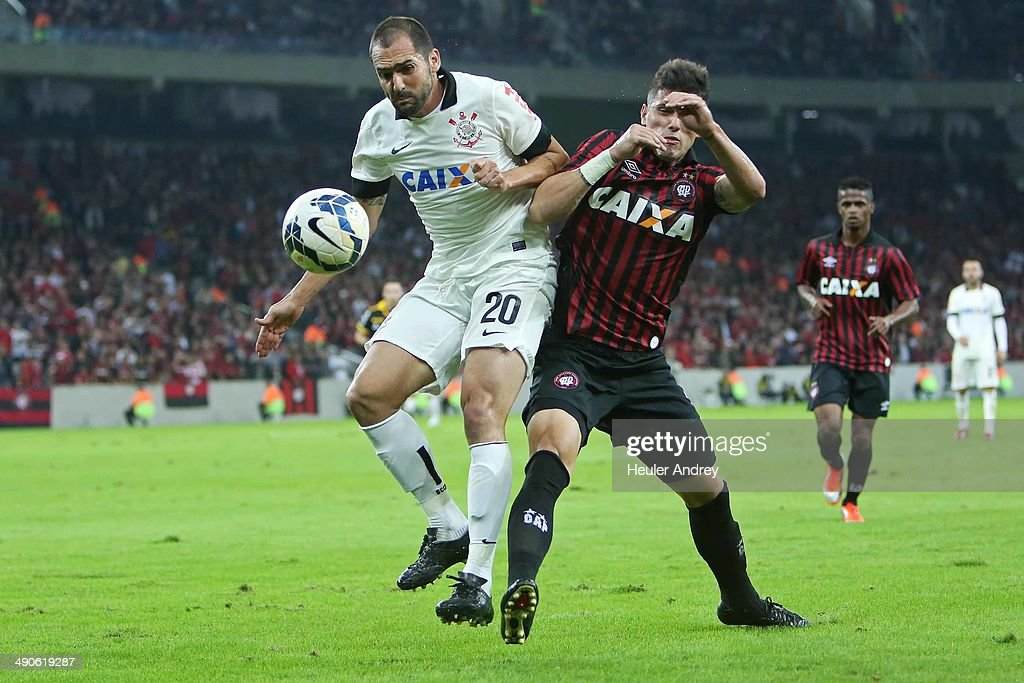 Drauzio of Atletico-PR competes for the ball with Danilo of Corinthians during the match between Atletico-PR and Corinthians for the Test Event FIFA at Arena da Baixada stadium on May 14, 2014 in Curitiba, Brazil.