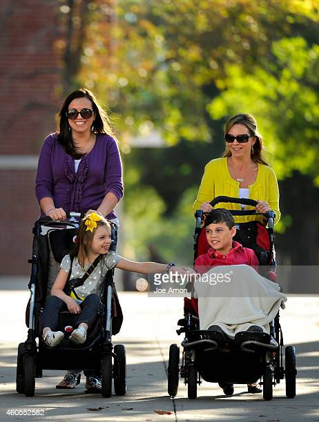 Dravet syndrome moms Mallory Johnson and Ana Watson with their kids Zoey and Preston walk to the state Capitol in support of caregiver Jason Cranford...