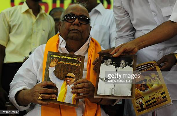 Dravida Munnetra Kazhagam leader MKarunanithi holds his party's election manifesto at a campaign event in Chennai on April 9 2016 State assembly...