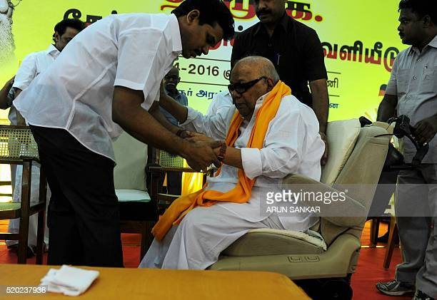 Dravida Munnetra Kazhagam leader MKarunanithi is helped from his chair at a campaign event in Chennai on April 9 2016 State assembly elections are...