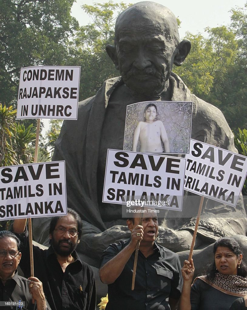 Dravida Munnetra Kazhagam (DMK) Members of Parliament shout slogans and wave placards with black dress during a protest against Sri Lankan President Mahinda Rajapaksa as they condemn the killing of Tamilians in Sri Lanka at Parliament House on March 5, 2013 in New Delhi, India. Both houses of Parliament were adjourned till noon after opposition parties raised various issues including the killing of a police officer in Uttar Pradesh and protests over the alleged killing of slain LTTE chief Prabhakaran's son in custody by Sri Lankan forces.
