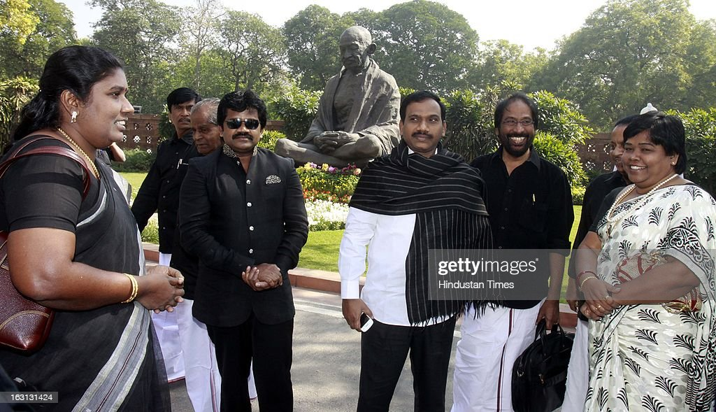 Dravida Munnetra Kazhagam (DMK) Members of Parliament with black dress during a protest against Sri Lankan President Mahinda Rajapaksa as they condemn the killing of Tamilians in Sri Lanka at Parliament House on March 5, 2013 in New Delhi, India. Both houses of Parliament were adjourned till noon after opposition parties raised various issues including the killing of a police officer in Uttar Pradesh and protests over the alleged killing of slain LTTE chief Prabhakaran's son in custody by Sri Lankan forces.