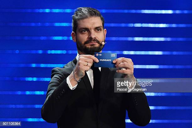 Draw assistant Angelos Charisteas draws out Hungary in to Group F during the UEFA Euro 2016 Final Draw Ceremony at Palais des Congres on December 12...