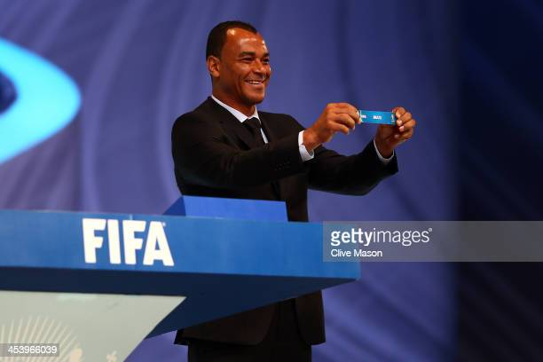 Draw assistant Cafu holds up the name of Brazil during the Final Draw for the 2014 FIFA World Cup Brazil at Costa do Sauipe Resort on December 6 2013...
