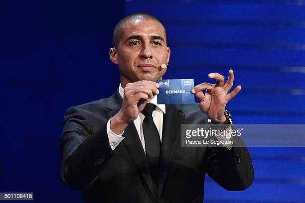 Draw assistant David Trezeguet draws out Germany in to Group C during the UEFA Euro 2016 Final Draw Ceremony at Palais des Congres on December 12...
