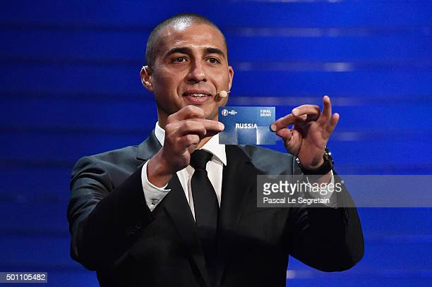 Draw assistant David Trezeguet draws out Russia in to Group B during the UEFA Euro 2016 Final Draw Ceremony at Palais des Congres on December 12 2015...