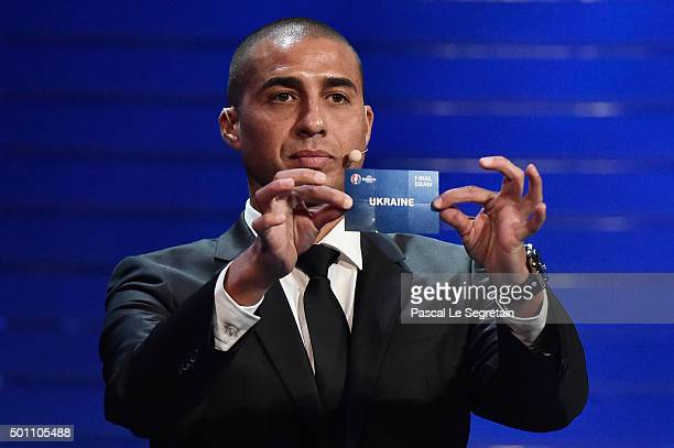 Draw assistant David Trezeguet draws out Ukraine in to Group C during the UEFA Euro 2016 Final Draw Ceremony at Palais des Congres on December 12...