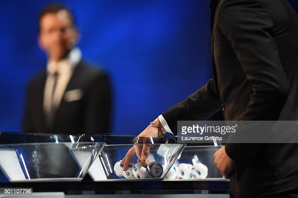 Draw assistant David Trezeguet puts his hand in a jar during the UEFA Euro 2016 Final Draw Ceremony at Palais des Congres on December 12 2015 in...