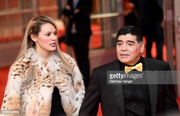 Draw assistant Diego Maradona and his girlfriend Rocío Oliva arrives prior to the Final Draw for the 2018 FIFA World Cup Russia at the State Kremlin...
