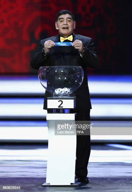 Draw assistant Diego Maradona draws Spain during the Final Draw for the 2018 FIFA World Cup Russia at the State Kremlin Palace on December 1 2017 in...
