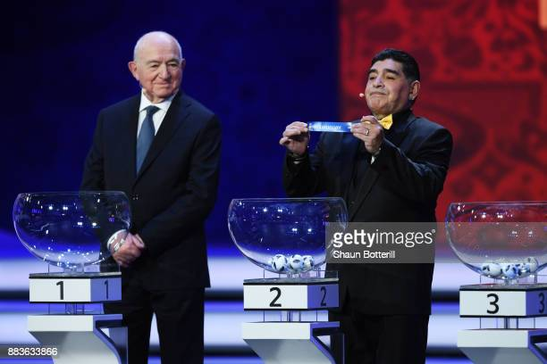 Draw assistant Diego Maradona draws Uruguay during the Final Draw for the 2018 FIFA World Cup Russia at the State Kremlin Palace on December 1 2017...