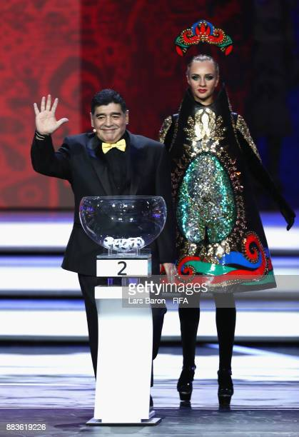 Draw assistant Diego Maradona waves to the crowd as he enters the stage during the Final Draw for the 2018 FIFA World Cup Russia at the State Kremlin...