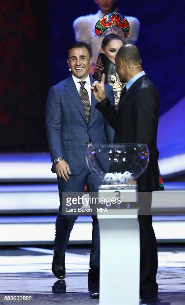 Draw assistant Fabio Cannavaro and draw assistant Cafu share a laugh during the Final Draw for the 2018 FIFA World Cup Russia at the State Kremlin...