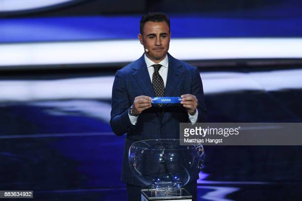 Draw assistant Fabio Cannavaro draws Japan during the Final Draw for the 2018 FIFA World Cup Russia at the State Kremlin Palace on December 1 2017 in...