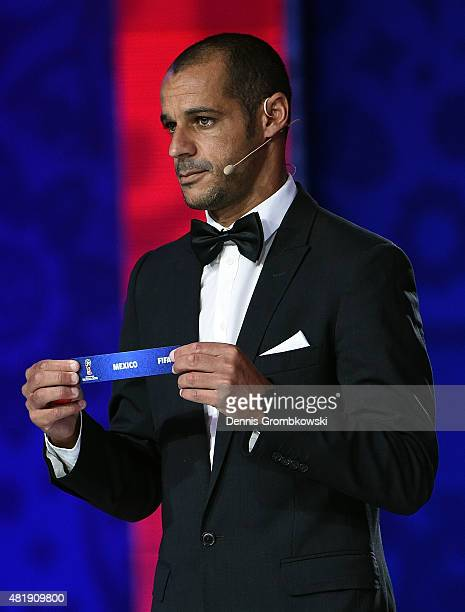 Draw assistant Madjer holds up the name Mexico in the North Central American and Caribbean Zone Draw during the Preliminary Draw of the 2018 FIFA...