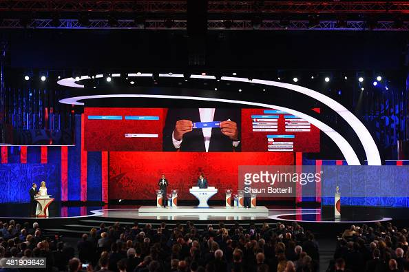 Draw assistant Madjer holds up the name United States in the North Central American and Caribbean Zone Draw during the Preliminary Draw of the 2018...