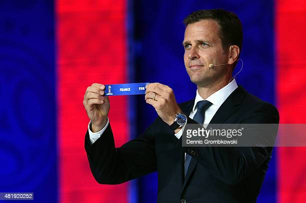 Draw assistant Oliver Bierhoff holds up the name France during the European Zone draw at the Preliminary Draw of the 2018 FIFA World Cup in Russia at...