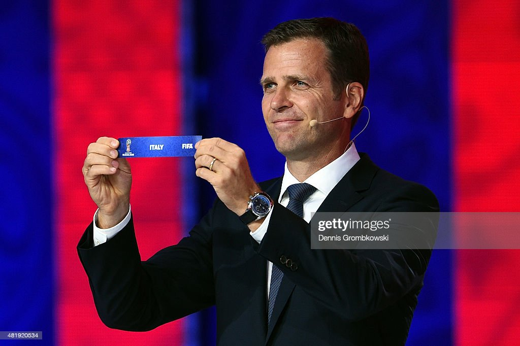 Draw assistant <a gi-track='captionPersonalityLinkClicked' href=/galleries/search?phrase=Oliver+Bierhoff&family=editorial&specificpeople=213661 ng-click='$event.stopPropagation()'>Oliver Bierhoff</a> holds up the name Italy during the European Zone draw at the Preliminary Draw of the 2018 FIFA World Cup in Russia at The Konstantin Palace on July 25, 2015 in Saint Petersburg, Russia.