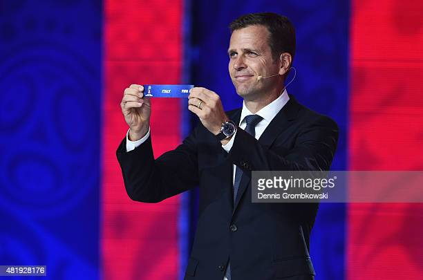Draw assistant Oliver Bierhoff holds up the name Italy during the European Zone draw at the Preliminary Draw of the 2018 FIFA World Cup in Russia at...