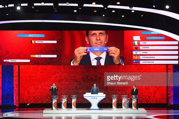 Draw assistant Oliver Bierhoff holds up the name Spain during the European Zone draw at the Preliminary Draw of the 2018 FIFA World Cup in Russia at...