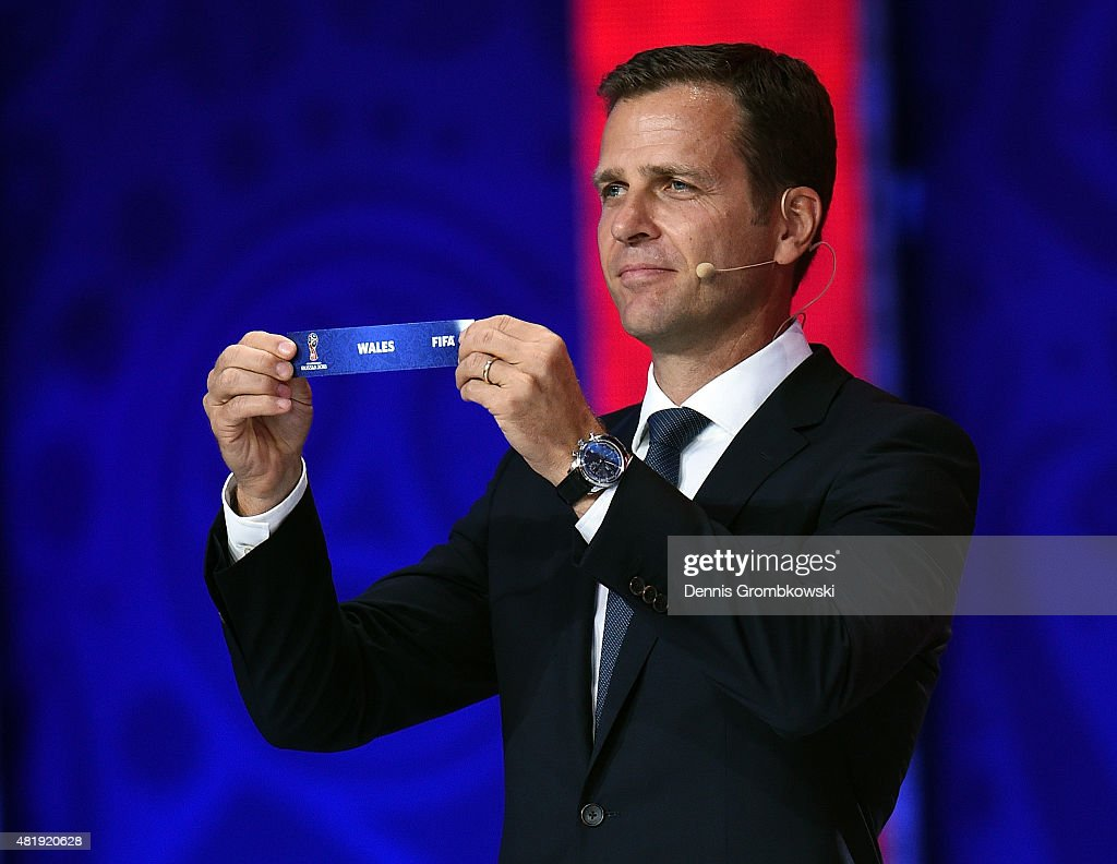 Draw assistant <a gi-track='captionPersonalityLinkClicked' href=/galleries/search?phrase=Oliver+Bierhoff&family=editorial&specificpeople=213661 ng-click='$event.stopPropagation()'>Oliver Bierhoff</a> holds up the name Wales during the European Zone draw at the Preliminary Draw of the 2018 FIFA World Cup in Russia at The Konstantin Palace on July 25, 2015 in Saint Petersburg, Russia.