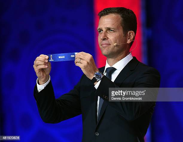 Draw assistant Oliver Bierhoff holds up the name Wales during the European Zone draw at the Preliminary Draw of the 2018 FIFA World Cup in Russia at...