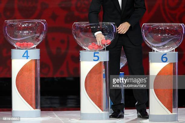 A draw assistant picks a ball during the preliminary draw for the Union of European Football Associations zone for the 2018 World Cup qualifiers at...