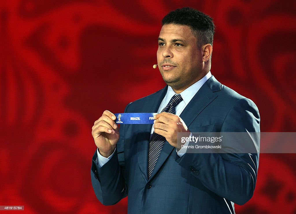 Draw assistant <a gi-track='captionPersonalityLinkClicked' href=/galleries/search?phrase=Ronaldo&family=editorial&specificpeople=185240 ng-click='$event.stopPropagation()'>Ronaldo</a> holds up the name Brazil during the South American Zone draw at the Preliminary Draw of the 2018 FIFA World Cup in Russia at The Konstantin Palace on July 25, 2015 in Saint Petersburg, Russia.