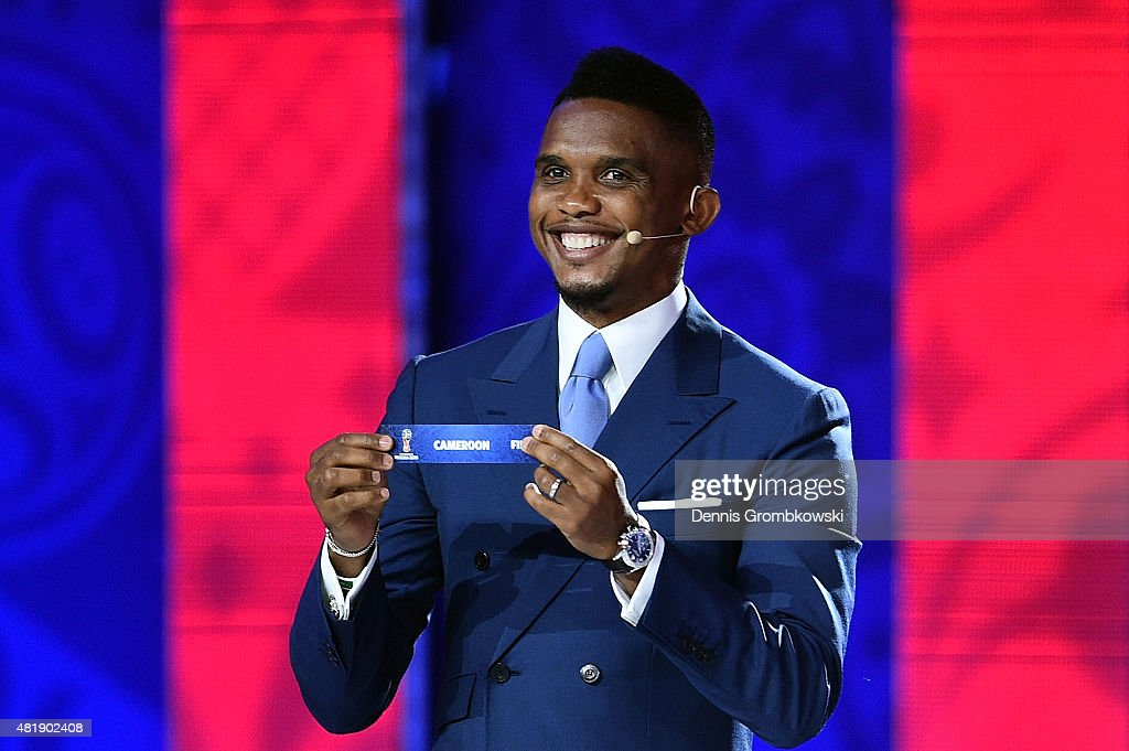 Draw assistant <a gi-track='captionPersonalityLinkClicked' href=/galleries/search?phrase=Samuel+Eto%27o&family=editorial&specificpeople=210530 ng-click='$event.stopPropagation()'>Samuel Eto'o</a> draws Cameroon in African Zone draw at the Preliminary Draw of the 2018 FIFA World Cup in Russia at The Konstantin Palace on July 25, 2015 in Saint Petersburg, Russia.