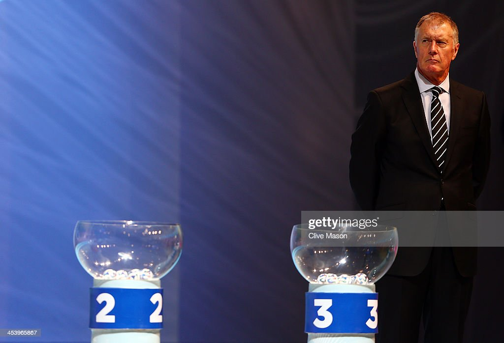 Draw assistant Sir <a gi-track='captionPersonalityLinkClicked' href=/galleries/search?phrase=Geoff+Hurst&family=editorial&specificpeople=206880 ng-click='$event.stopPropagation()'>Geoff Hurst</a> waits behind the pots during the Final Draw for the 2014 FIFA World Cup Brazil at Costa do Sauipe Resort on December 6, 2013 in Costa do Sauipe, Bahia, Brazil.