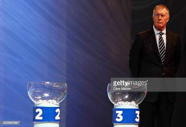 Draw assistant Sir Geoff Hurst waits behind the pots during the Final Draw for the 2014 FIFA World Cup Brazil at Costa do Sauipe Resort on December 6...