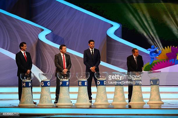 Draw assistants Mario Kempes Lothar Matthaus Fernando Hierro and Alcides Ghiggia wait behind the pots during the Final Draw for the 2014 FIFA World...