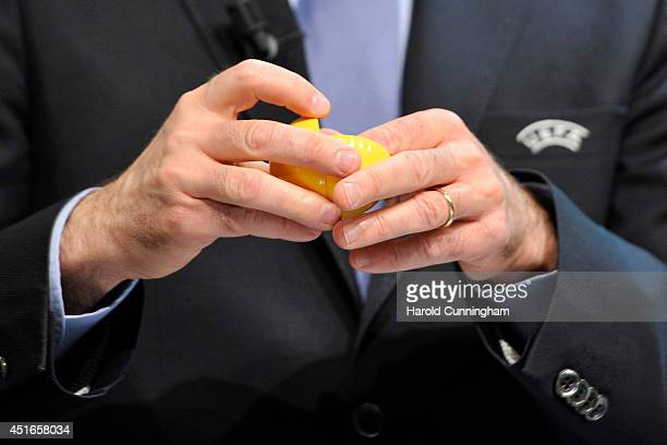 A draw ball is opened during the UEFA 2014/15 Futsal Cup Preliminary and Main Round Draw at the UEFA headquarters The House of European Football on...