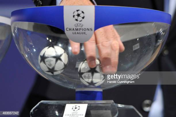 Draw balls are shuffled during the 2014/15 UEFA Champions League Playoff round draw at the UEFA headquarters The House of European Football on August...