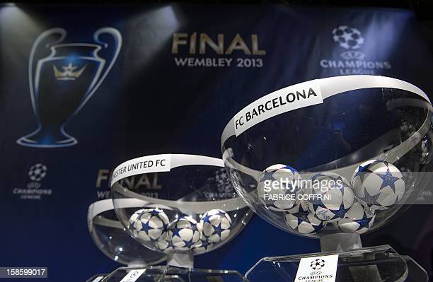 Draw balls of Manchester United FC and FC Barcelona sit in bowls awaiting the draw for the last 16 of the UEFA Champions League on December 20 2012...