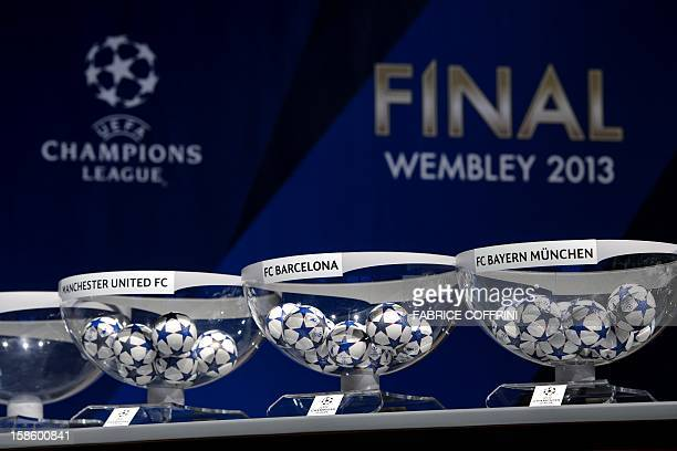 Draw balls of Manchester United FC FC Barcelona and Bayern Munich sit in bowls awaiting the draw for the last 16 of the UEFA Champions League on...
