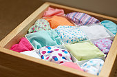 Drawer containing folded underwear, separated by dividers