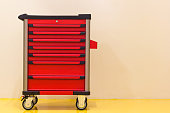 Drawer roller tool cabinet or mobile tool cabinet parking on the yellow epoxy floor