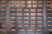 Drawers of homeopathic herbal medicines in pharmacy