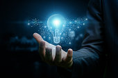 Drawing a light bulb in hand businessman. The concept of the business idea.