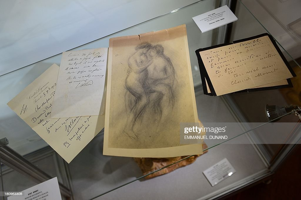 A drawing and letters which belonged to French artist Pierre-August Renoir are on display at Heritage Auctions in New York, September 18, 2013. The single-largest archive of Renoir's personally-owned object, sculptures and letters are set to go on auction on September 19, 2013. AFP PHOTO/Emmanuel Dunand