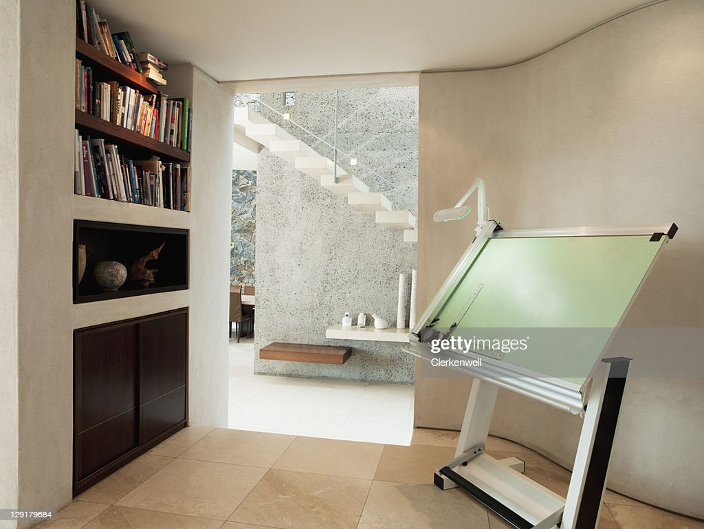 Drawing board and bookshelf in luxury home : Stock Photo
