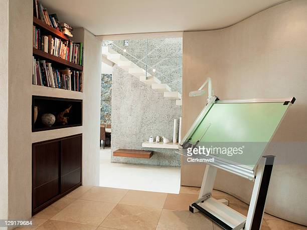 Drawing board and bookshelf in luxury home