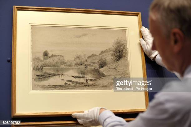 A drawing by Camille Pissaro dated c1865 titled Figures at the Banks of the Marne near Chennevieres is viewed at The Wallace Collection in London as...
