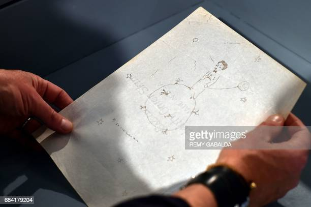 A drawing by Frenchman Antoine de SaintExupéry is shown at the Museum of Old Toulouse on May 17 prior to the set of 12 drawings and 7 letters by...